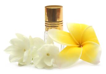 Jasmine flower and frangipani with perfume bottle