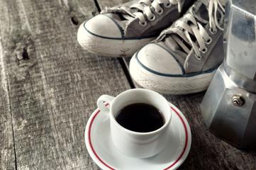 Espresso coffee, espresso maker and dirty sneakers