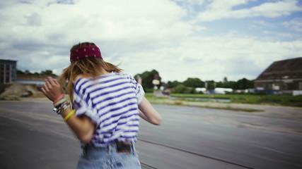 Teenager running carefree in urban area