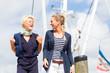 canvas print picture - Freundinnen am Jachthafen