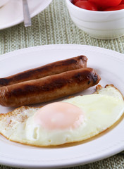 Fried egg and sausage links