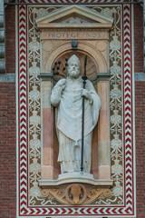 Statue of a prist in Courtyard of Castello Sforzesco, Milan, Ita