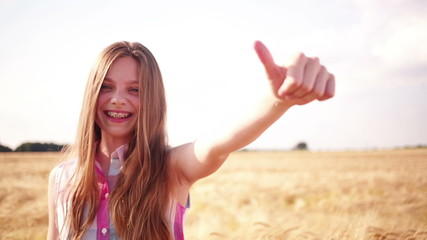Young Girl Showing Thumbs Up To Camera