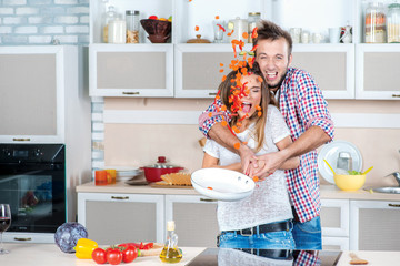 Enjoying cooking together. Young and beautiful couple in love pr