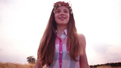 Young Girl WalkingThrough Wheat Fields