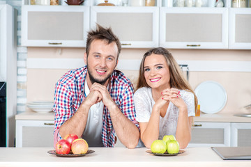 Wholesome food. Young couple in love fold their arms while stand
