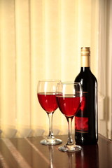 Red wine in glasses and bottle.