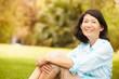 canvas print picture - Portrait Of Senior Asian Woman Sitting In Park