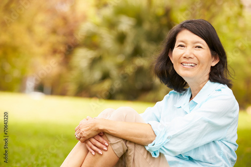 canvas print picture Portrait Of Senior Asian Woman Sitting In Park