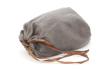 grey drawstring pouch with brown ribbon on white background