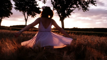 Woman Twirling in Wheat Field