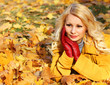 Autumn Woman with Maple leaves. Blonde Beautiful Girl in Fall