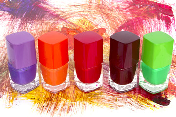 Bottles with spilled nail polish isolated on white background