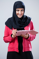 Muslim girl using tablet