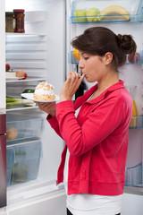 Girl eating cream cake