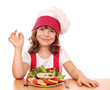 little girl cook with salmon sea food