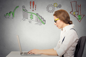 Woman working on computer, anticipation of financial crisis