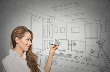 woman designer drawing with pen, pencil future apartment