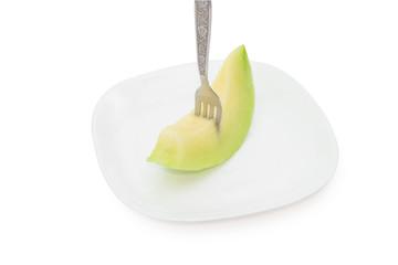 cantaloupe melon fruit in dish Isolated on white background