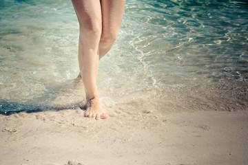 Girls stands on a beach