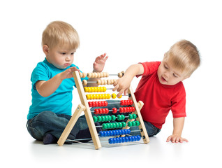 Kids playing colorful abacus or counter together