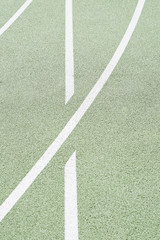 Sporting boundary lines on green pitch.