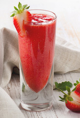 Strawberry smoothie on a wooden background
