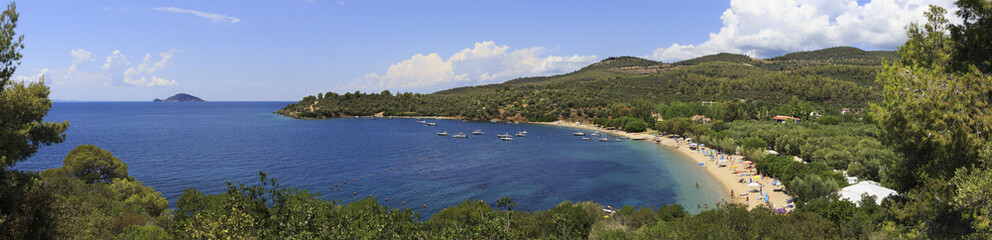 Panorama of beautiful bay of Aegean Sea with sandy beach.
