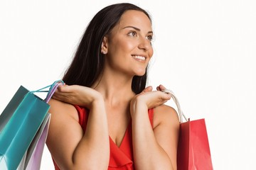 Woman standing with shopping bags