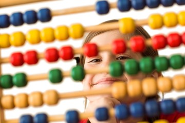 Cute little girl using an abacus