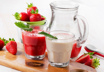 Strawberry smoothie on wooden background