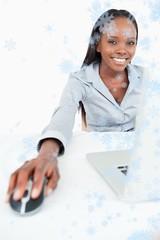 Portrait of a cute businesswoman using a laptop