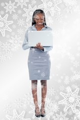 Portrait of a smiling businesswoman using a laptop