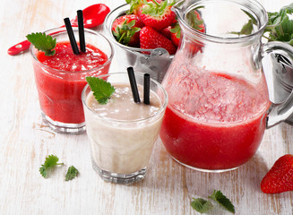 Strawberry smoothie with  berries on a wooden background