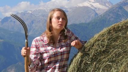 beautiful farm girl with pitchfork