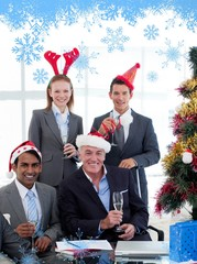 Smiling business people wearing novelty christmas hat