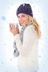 Pretty blonde in winter fashion holding mug