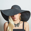 Beautiful Blond Woman in Black Hat.Elegance Girl.Accessories
