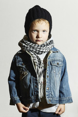 fashionable little boy in scarf and jeans.Fashion kids.child