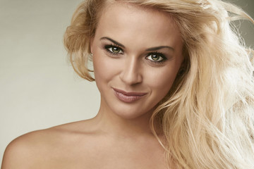 Beautiful smiling blond woman.happy girl.pretty young woman