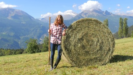 beautiful farm girl with pitchfork