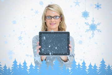 Happy woman presenting her tablet