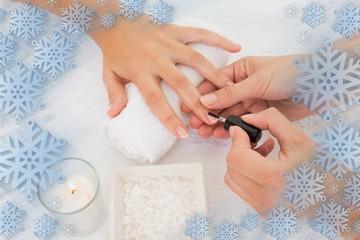 Nail technician painting customers nails