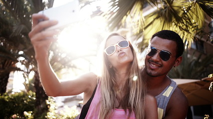 Couple takes selfie togeher and shows thumbs up