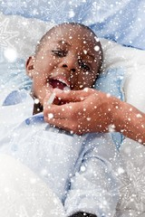 Composite image of small boy sick in bed