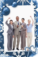 Composite image of happy business team holding a cup