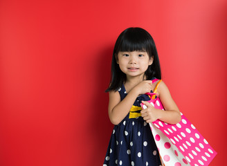 Child with shopping bags