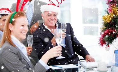 Composite image of businessman team celebrating christmas