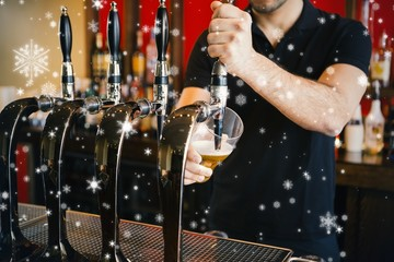 Composite image of barkeeper pulling a pint of beer