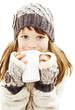 Smiling little girl with a white cup of hot drink